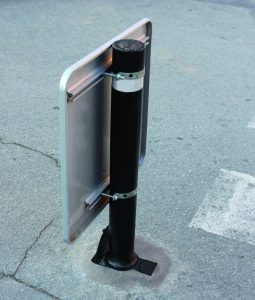 A resist bollard personalized with plate